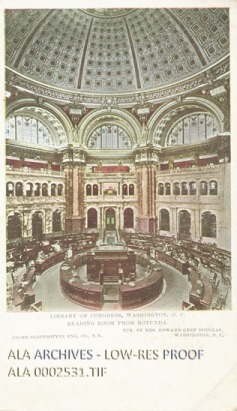 A large reading room with a dome, arches, and circular desks.