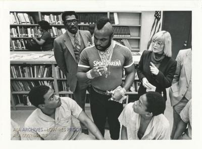 """Actor """"Mr. T.,"""" who played Stallone's boxing opponent in Rocky III, tells library patrons how reading can influence their lives."""