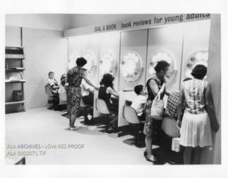 A group of children and adults at an exhibit.