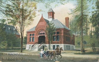 A picture of a red library building with a horse-draw carriage in front of it.