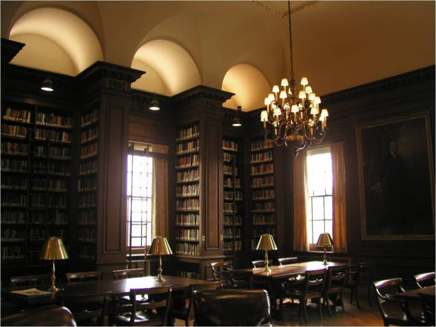 Kirby Library, showing oak furniture and book stacks.
