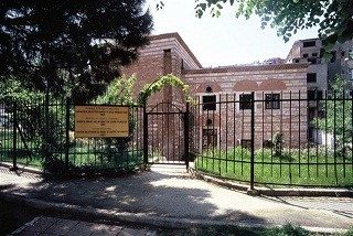 A pciture of a library with a gate in front of it