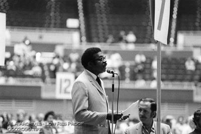 An African-American man speaking in an auditorium.
