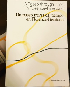 A book with curvy yellow and black lines with the title A Paseo through Time in Florence-Firestone