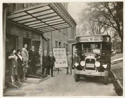 A book bus (bookmobile) in front of a library with FDR and several other people.