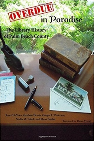 Rare books, photo of historic library, pens, check out cards, against Florida flora backdrop