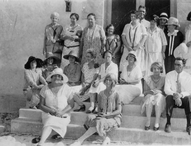A b-and-w photo of people sitting on steps, 1920s clothing