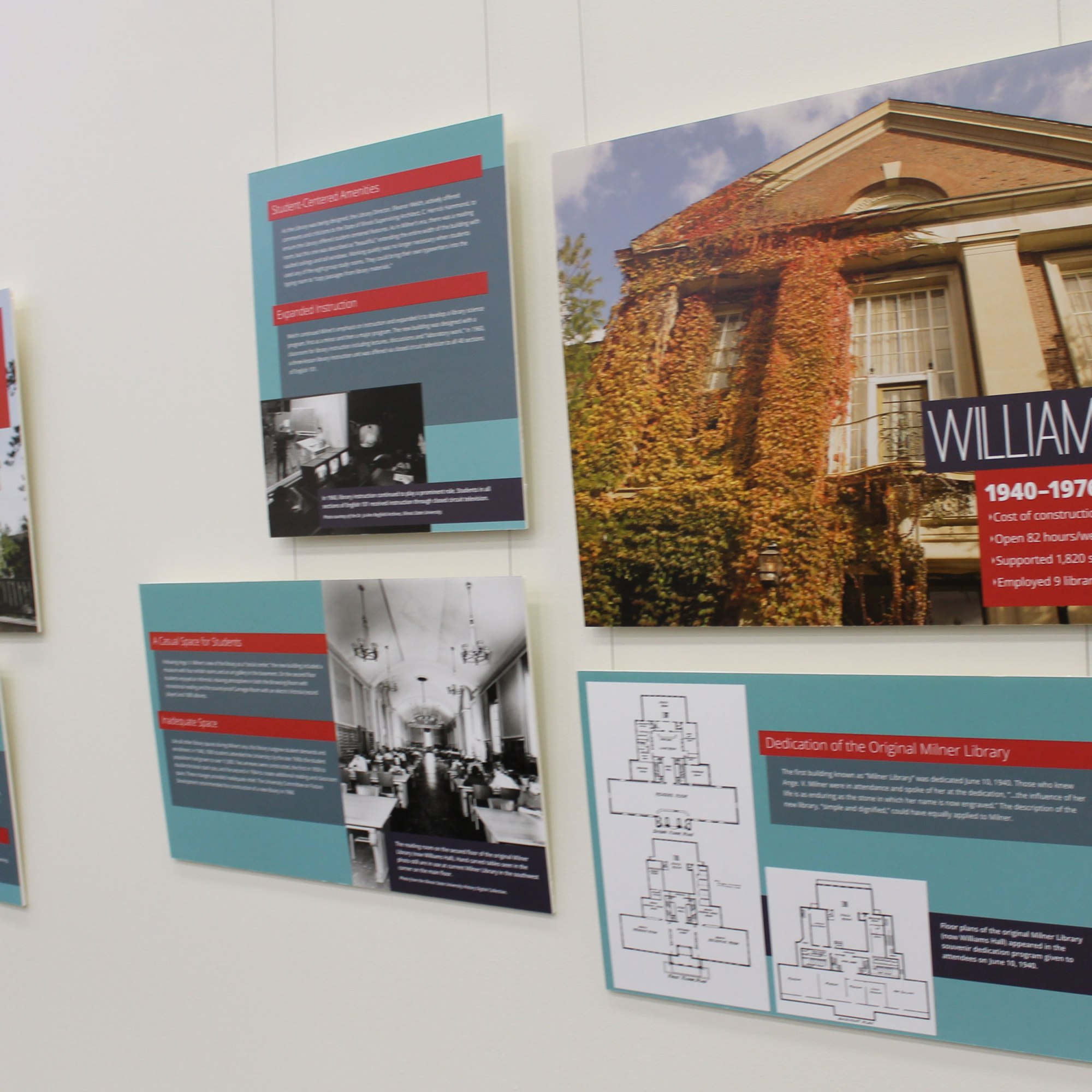 """Photos on a wall, one of the photos says """"Williams Hall"""" Another features blueprints. Other shows historic photos of activities inside the library."""